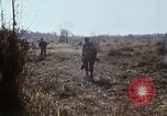 Image of UH-1D helicopter Cambodia, 1968, second 51 stock footage video 65675030471