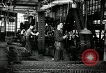 Image of half track tread assembly line Akron Ohio USA, 1941, second 3 stock footage video 65675030485