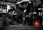 Image of half track tread assembly line Akron Ohio USA, 1941, second 4 stock footage video 65675030485