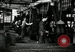 Image of half track tread assembly line Akron Ohio USA, 1941, second 5 stock footage video 65675030485