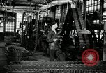 Image of half track tread assembly line Akron Ohio USA, 1941, second 8 stock footage video 65675030485