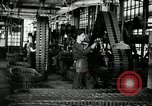 Image of half track tread assembly line Akron Ohio USA, 1941, second 18 stock footage video 65675030485