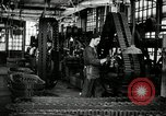 Image of half track tread assembly line Akron Ohio USA, 1941, second 20 stock footage video 65675030485