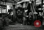 Image of half track tread assembly line Akron Ohio USA, 1941, second 21 stock footage video 65675030485