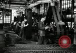 Image of half track tread assembly line Akron Ohio USA, 1941, second 22 stock footage video 65675030485