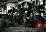 Image of half track tread assembly line Akron Ohio USA, 1941, second 23 stock footage video 65675030485