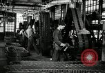 Image of half track tread assembly line Akron Ohio USA, 1941, second 25 stock footage video 65675030485