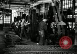 Image of half track tread assembly line Akron Ohio USA, 1941, second 27 stock footage video 65675030485