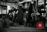 Image of half track tread assembly line Akron Ohio USA, 1941, second 28 stock footage video 65675030485