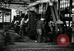 Image of half track tread assembly line Akron Ohio USA, 1941, second 30 stock footage video 65675030485