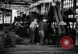 Image of half track tread assembly line Akron Ohio USA, 1941, second 33 stock footage video 65675030485