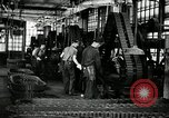 Image of half track tread assembly line Akron Ohio USA, 1941, second 35 stock footage video 65675030485