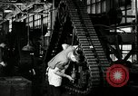 Image of half track tread assembly line Akron Ohio USA, 1941, second 36 stock footage video 65675030485