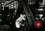Image of half track tread assembly line Akron Ohio USA, 1941, second 37 stock footage video 65675030485