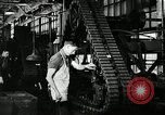 Image of half track tread assembly line Akron Ohio USA, 1941, second 39 stock footage video 65675030485