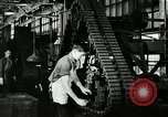 Image of half track tread assembly line Akron Ohio USA, 1941, second 40 stock footage video 65675030485