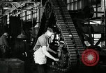 Image of half track tread assembly line Akron Ohio USA, 1941, second 44 stock footage video 65675030485