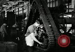 Image of half track tread assembly line Akron Ohio USA, 1941, second 45 stock footage video 65675030485
