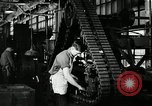 Image of half track tread assembly line Akron Ohio USA, 1941, second 46 stock footage video 65675030485