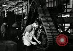 Image of half track tread assembly line Akron Ohio USA, 1941, second 47 stock footage video 65675030485