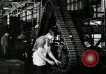 Image of half track tread assembly line Akron Ohio USA, 1941, second 48 stock footage video 65675030485