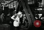 Image of half track tread assembly line Akron Ohio USA, 1941, second 50 stock footage video 65675030485