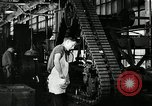 Image of half track tread assembly line Akron Ohio USA, 1941, second 51 stock footage video 65675030485