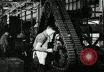 Image of half track tread assembly line Akron Ohio USA, 1941, second 52 stock footage video 65675030485
