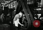 Image of half track tread assembly line Akron Ohio USA, 1941, second 54 stock footage video 65675030485