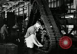 Image of half track tread assembly line Akron Ohio USA, 1941, second 55 stock footage video 65675030485