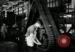Image of half track tread assembly line Akron Ohio USA, 1941, second 56 stock footage video 65675030485