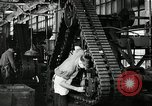 Image of half track tread assembly line Akron Ohio USA, 1941, second 57 stock footage video 65675030485