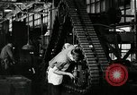 Image of half track tread assembly line Akron Ohio USA, 1941, second 58 stock footage video 65675030485