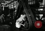 Image of half track tread assembly line Akron Ohio USA, 1941, second 60 stock footage video 65675030485
