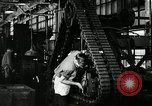 Image of half track tread assembly line Akron Ohio USA, 1941, second 61 stock footage video 65675030485