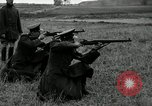 Image of Visiting Latin American military officers firing Garand rifles Fort Riley Kansas USA, 1942, second 24 stock footage video 65675030497