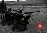 Image of Visiting Latin American military officers firing Garand rifles Fort Riley Kansas USA, 1942, second 25 stock footage video 65675030497