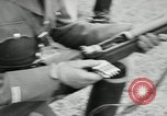 Image of Visiting Latin American military officers firing Garand rifles Fort Riley Kansas USA, 1942, second 40 stock footage video 65675030497