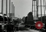 Image of jobs at factories in America during Great Depression United States USA, 1932, second 15 stock footage video 65675030527