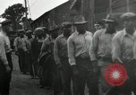 Image of jobs at factories in America during Great Depression United States USA, 1932, second 21 stock footage video 65675030527