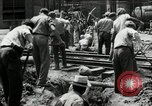 Image of jobs at factories in America during Great Depression United States USA, 1932, second 25 stock footage video 65675030527