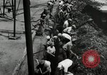 Image of jobs at factories in America during Great Depression United States USA, 1932, second 32 stock footage video 65675030527