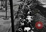 Image of jobs at factories in America during Great Depression United States USA, 1932, second 33 stock footage video 65675030527