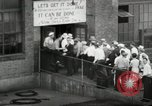 Image of jobs at factories in America during Great Depression United States USA, 1932, second 39 stock footage video 65675030527