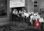 Image of jobs at factories in America during Great Depression United States USA, 1932, second 40 stock footage video 65675030527