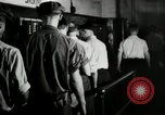Image of jobs at factories in America during Great Depression United States USA, 1932, second 44 stock footage video 65675030527