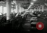 Image of jobs at factories in America during Great Depression United States USA, 1932, second 45 stock footage video 65675030527