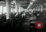 Image of jobs at factories in America during Great Depression United States USA, 1932, second 46 stock footage video 65675030527