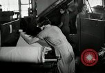 Image of jobs at factories in America during Great Depression United States USA, 1932, second 49 stock footage video 65675030527