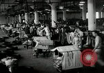 Image of jobs at factories in America during Great Depression United States USA, 1932, second 54 stock footage video 65675030527